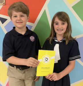 Two Private Schools kids smiling and posing with Young Pegasus Poetry book after winning